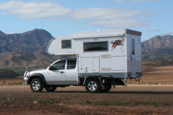 Ozcape Slide-On motorhome Woondabaa side view with mountains in background